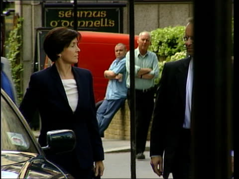 London Lord Archer holding open car door for his wife Mary on arrival at the Old Bailey to answer charges of perjury and conspiracy to pervert the...