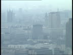 16 ENGLAND London Ext National Westminster Tower/ GVs City rooftops/ Tower Bridge seen/ More GVs rooftops/ Dome of St Paul's Cathedral/ Smoke...