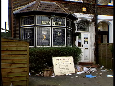 LIB ENGLAND London EXT Nursery school hit by measles outbreak TILT DOWN CMS Sign in window warning of measles outbreak Sign for the Abacus Early...