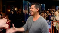 EXT Simon Cowell shaking hands with fans ** BEWARE