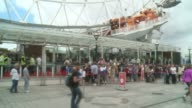 London Eye evacuated after unexploded WW2 bomb found in River Thames ENGLAND London London Eye EXT People queuing outside London Eye London Eye...