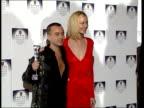 Designer of the Year award ENGLAND London Designer of year winner Julien MacDonald standing with actress Joely Richardson