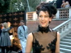 Launch party / 'Moet Mirage' / interviews Maria Grachvogel wearing long black dress with semitransparent top high neck and feathered headdress posing...