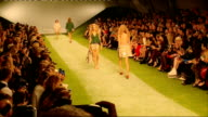 Top Shop show interviews General views people inside crowded tent for fashion show / General views 2013 Top Shop Fashion Show as various models...