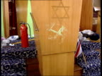 London Finsbury Park Synagogue Damaged interior of synagogue which was attacked by racists Swastika painted on lectern PAN rabbi clearing bebris...