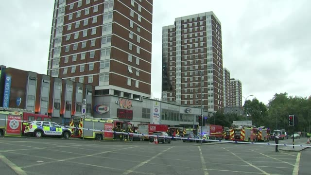 London Fire Bridgade warning on fire risk of faulty electrical goods R19081606 / Shepherd's Bush EXT Fire engines at scene of tower block fire London...