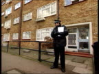 London Forest Gate EXT MS Police officer standing outside block of flats where convicted paedophile William Malcolm was shot dead in suspected...