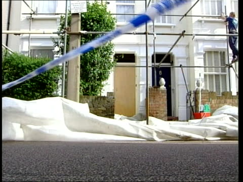 London Fulham Seq Workers removing tarpaulin screen from front of murdered TV presenter Jill Dando's house i/c John Jones interviewed SOT Describes...