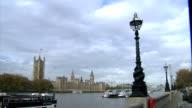 General views of landmark sites Houses of Parliament General views across River Thames from Albert Embankment including pleasure boat along river