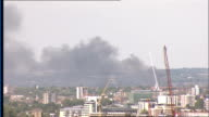 London GIR EXT Grey cloud of smoke seen in distance from top of Central London building