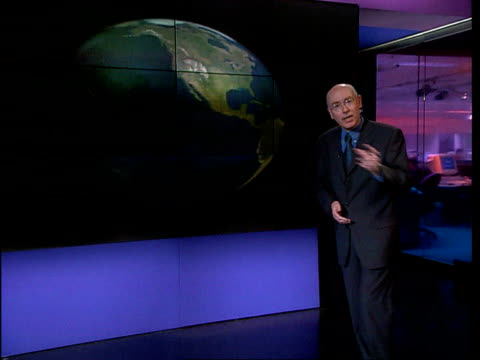 London GIR INT i/c with video wall graphics explaining El Nino and La Nina GRAPHIC Sea temperatures Dr Mark Saunders interview SOT We know La Nina is...