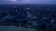 dusk and night Continuous shot following course of River Thames heading west passing over Millennium Dome and Canary Wharf skyscrapers including...