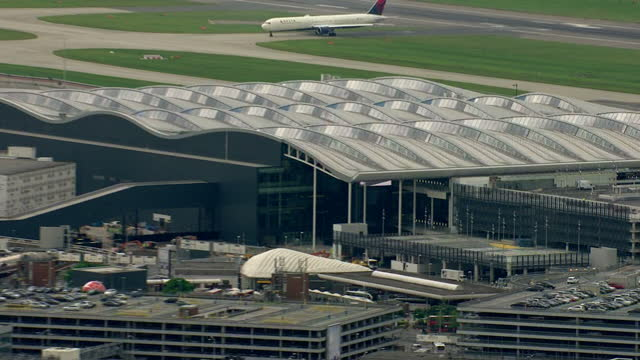 London Heathrow airport aerials Terminal 2 with planes on runways of the busiest airport in the world on June 23 2014 in London England