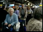 London Heathrow Airport INT GVs Passengers queuing in checkin area