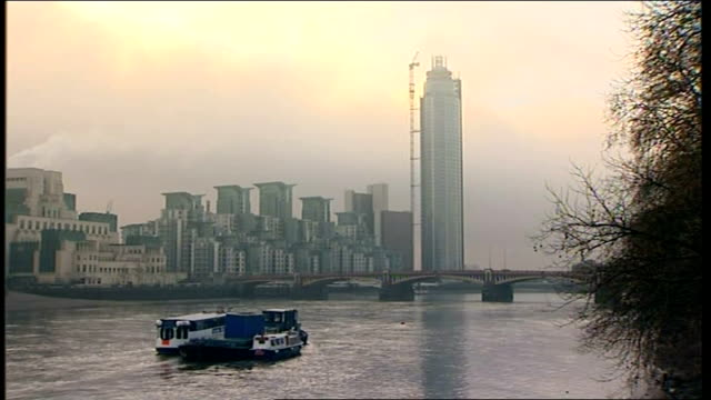 Geenral views St George's Wharf Tower ENGLAND London Vauxhall EXT St George's Wharf tower and damaged crane next to building with river Thames in...
