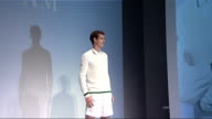 London INT FLASH Andy Murray modelling allwhite tennis sportswear on catwalk Photographers Andy Murray interview SOT Feel much more comfortable on...