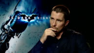 London INT Christian Bale interview SOT On Heath Ledger's performance as The Joker / On taking their roles seriously but understanding that acting is...