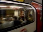 LIB ENGLAND London INT London Underground train arriving at Victoria station Tape across closing off escalators INT TRAIN Passengers boarding tube...