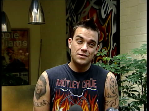 London Robbie Williams speaking to press SOT Mum said it would be really uncouth of me to talk about money but I'm rich beyond my wildest dreams