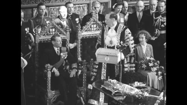 London Lord Mayor Lowson seated in center with King Frederick IX of Denmark on his right and Queen Ingrid on his left as they listen to scroll of...