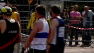 Runners at finish / Bill Neely interview ENGLAND London EXT General views of marathon runners at end of London Marathon / runner being pushed along...