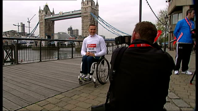 preview ENGLAND London EXT David Weir 2014 London Marathon photocall with Tower Bridge in background David Weir interview SOT looking for record...