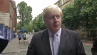 London Mayor Boris Johnson joined police for cycle safety crackdown Shows exterior shot of Boris Johnson Lord Mayor of London answering journalists...