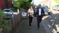 results Sadiq Khan heading for victory ENGLAND London EXT Sadiq Khan and wife Saadiya Khan towards Officials at vote count Counting machine
