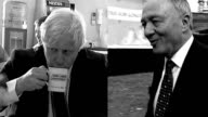 polls suggest contest is too close to call ENGLAND London Boris Johnson drinking cup of tea / Ken Livingstone along past camera