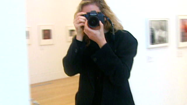 London National Portrait Gallery INT Annie Leibovitz taking pictures and at opening of show of her work