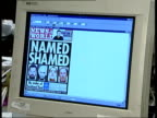 London News of the World INT CMS Newsroom computer showing front page of newspaper with headline 'Named Shamed' and photographs of paedophiles LA MS...
