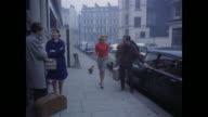 1961 - London - People getting in cars in South Kensington