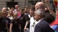 London Pride parade Sadiq Khan Saadiya Khan and Matthew Barzun pose for photos with others