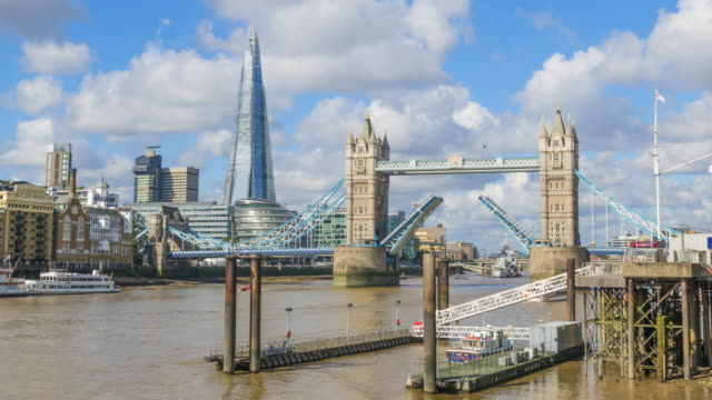 London skyline with Tower Bridge and the Shard viewed from the River Thames, time lapse