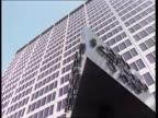 Terrorist cell find CF ENGLAND London New Scotland Yard LA MS New Scotland Yard sign revolving as bldg in b/g Ditto