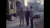 1961 - London - Three men outside apartment building.