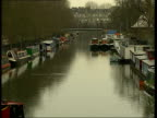 Inside property ITV ENGLAND London TGVs Barges and houseboats moored on canal