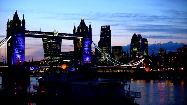 London Tower Bridge with skyline in the night