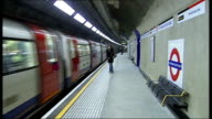 Tottenham Court Road Northern Line platforms reopen ENGLAND London Tottenham Court Road INT Sign on newly reopened platform PAN to tube train pulling...
