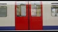London underground train leaving a station