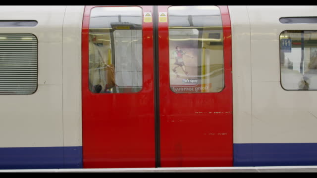 London underground train leaving a station