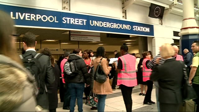 Tube strike Liverpool Street Station ENGLAND London Commuters sitting and standing on busy train / people disembarking train INT People along on...