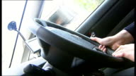 London vehicles trial speed limiters ENGLAND London Victoria Close Shot of foot pressing accelerator pedal in car Hands on steering wheel of car...