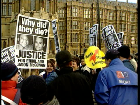 London Westminster EXT Demonstrators outside Houses of Parliament holding banners 'Justice for Errol Jason McGowan'