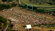 London Wimbledon EXT High angle view of Wimbledon tennis courts High angle view of crowd of people at Wimbledon Close up of Andy Murray and Andy...