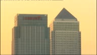 London wins deal for Chinese currency transactions ENGLAND London EXT Long shots of Canary Wharf financial skyscrapers against evening sky Andrew...