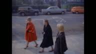 1961 - London - Women leave their apartment
