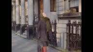 1961 - London - Women look at a walkup flat in Kensington