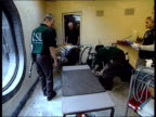 London Zoo breeding procedure for tigers INT MS Zoo staff carrying anaesthetised male tiger Lumpa into room on stretcher TBV MS Staff preparing tiger...