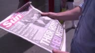 Londoners react after the front page of The Sun on Saturday published images allegedly showing a young Queen Elizabeth II giving a Nazi salute in the...